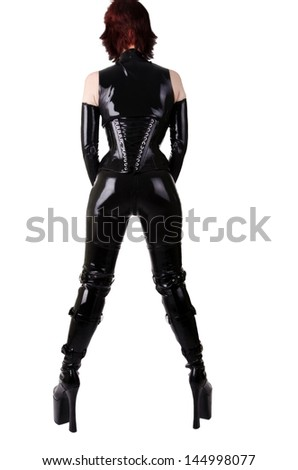 Sexy woman in latex suit, isolated on white background. - stock photo
