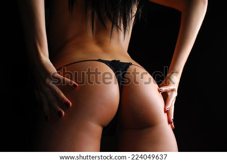 Sexy woman in lingerie on dark background - stock photo