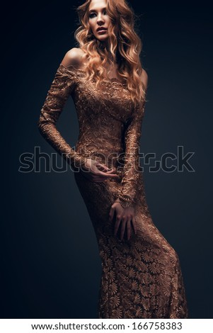 sexy woman in long gold dress - stock photo