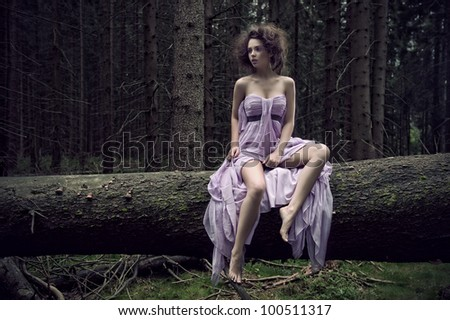 Sexy woman in nature scenery - stock photo