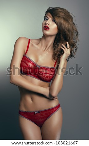 Sexy woman in red lingerie - stock photo