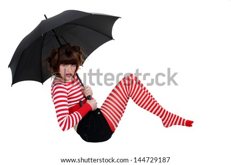 sexy woman in striped stockings holding umbrella - stock photo
