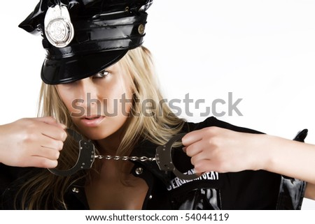 Sexy woman in uniform holding handcuffs - stock photo