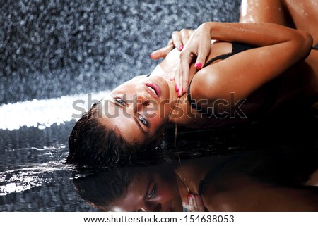 sexy woman in water studio - stock photo
