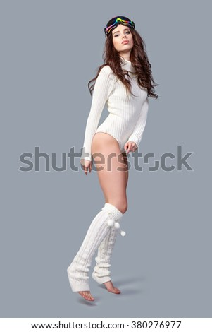 sexy woman in winter body sweater and  ski goggles - stock photo