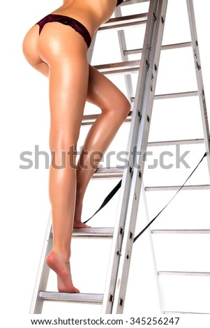 Sexy woman on a ladder, isolated on white background - stock photo