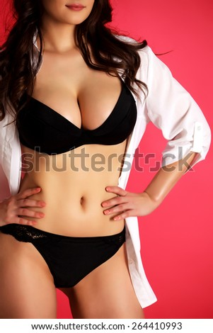 Sexy woman on a red background  - stock photo