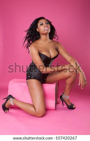 sexy woman on pink wearing corset - stock photo