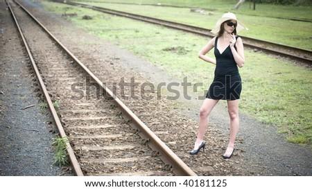 Sexy woman on railroad - stock photo