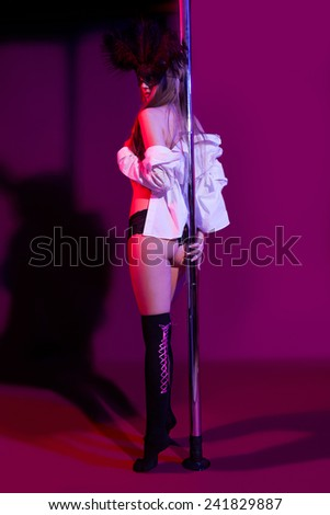 sexy woman pole dancer performing on stage - stock photo