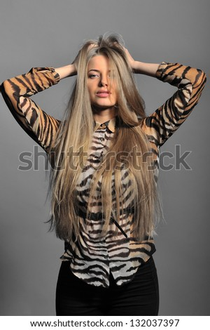 Sexy woman posing over grey background - stock photo