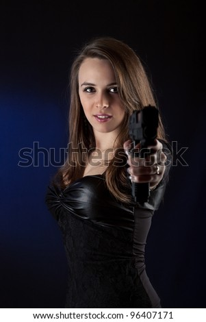 Sexy woman posing with pistol. - stock photo