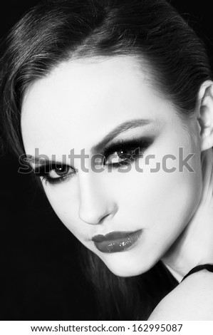 sexy woman's face. Perfect Skin �black background - stock photo