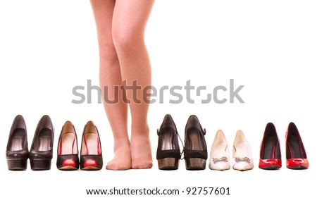 Sexy woman's legs with fashion shoes isolated on white background. - stock photo