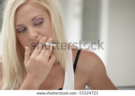 Sexy woman smoking - stock photo