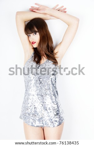 sexy woman wearing a shiny silver dress - stock photo