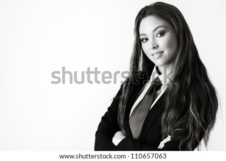 sexy woman wearing a suit with a shirt and tie - stock photo