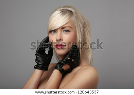 sexy woman wearing leather driving gloves - stock photo