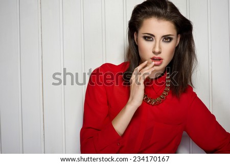 Sexy woman wearing red top. Party - stock photo