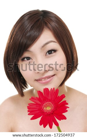 Sexy woman with a red gerbera, close-up, - stock photo