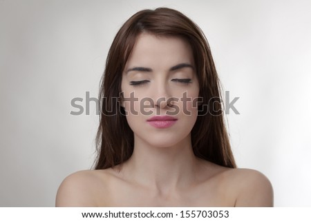 sexy woman with eyes closed facing the camera - stock photo