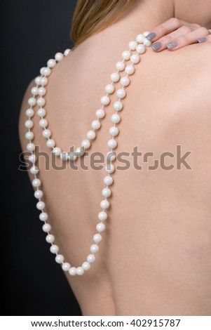 sexy woman with pearl necklace / Woman - stock photo