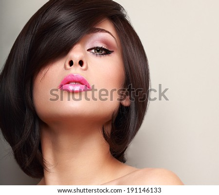 Sexy woman with straight black short hair and pink lips. Closeup - stock photo