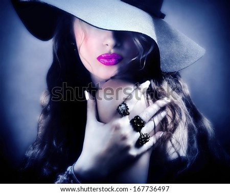 Sexy young beautiful pretty woman / model / lady with pink lips, vintage / retro hat and jewelry is sending a kiss / smooch - closeup  - stock photo