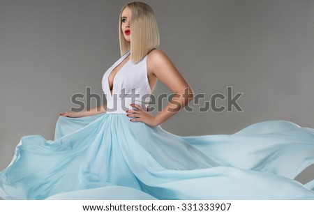 Sexy young beauty woman in fluttering dress. Beautiful Girl in blowing Dress Flying - stock photo