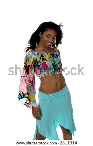 Sexy young Black woman in a blue skirt and a retro 60's pattern cropped blouse - stock photo