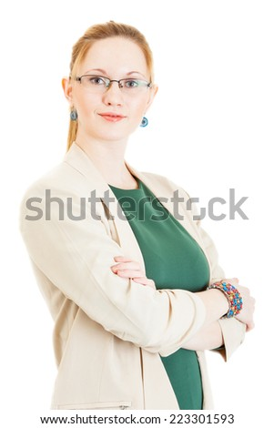 sexy young blonde girl wearing a green dress, jacket and glasses - stock photo