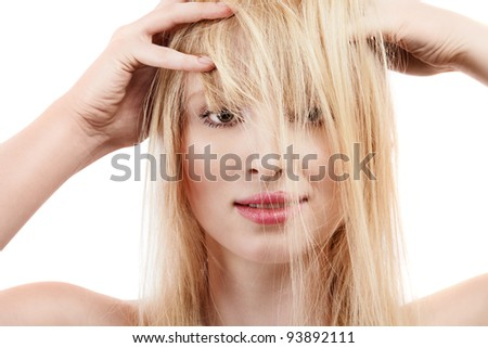 Sexy young blonde girl with long wild hair - stock photo