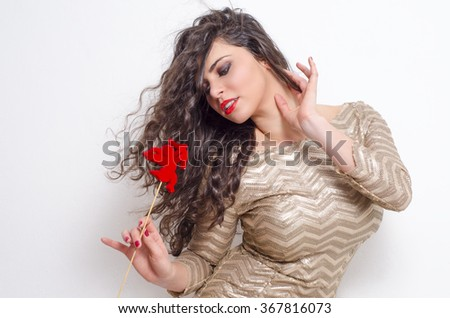 Sexy young brunette holding cupid, valentines day  - stock photo