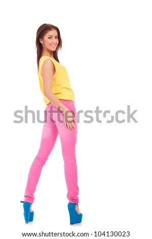 sexy young casual woman in colorful clothes standing on white background - stock photo