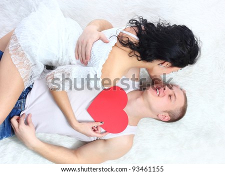 sexy young couple before kiss, lie on the floor - stock photo