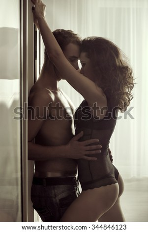 Sexy young couple hugging - stock photo