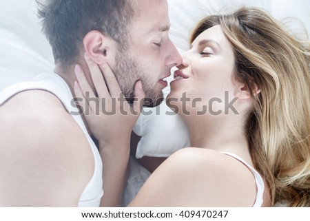 Sexy young couple kissing passionately each other - stock photo