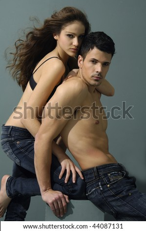 Sexy young couple wearing jeans - stock photo