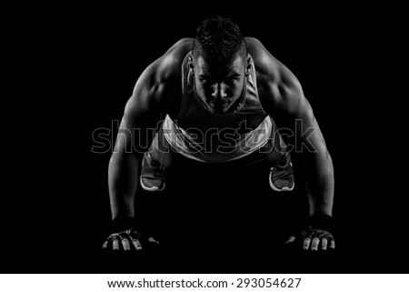 Sexy Young fashion sport man, fitness muscle model guy making push ups exercise  - stock photo