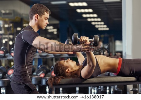 sexy young girl resting after barbell exercises. Fitness blonde woman - stock photo