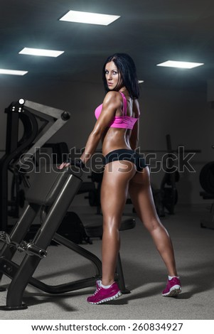sexy young girl resting after training. Fitness woman in sport wear with perfect fitness body resting in gym - stock photo
