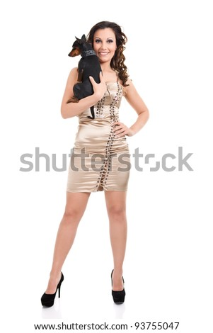 sexy young girl with miniature pincher, isolated on white background - stock photo