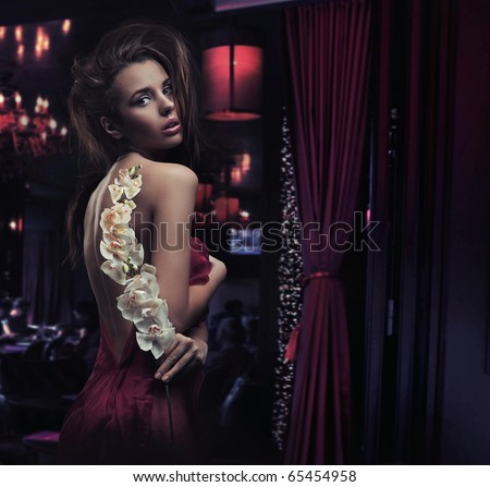 Sexy young lady with white orchid - stock photo