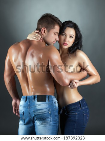Sexy young married couple posing at camera - stock photo