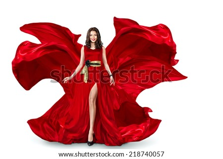 Sexy young motion woman in long red evening fluttering fashion dress flying isolated over white background - stock photo