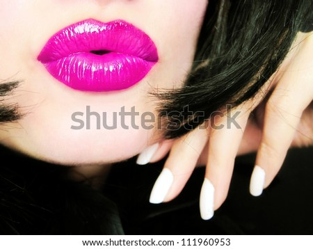 Sexy young pretty woman with pink lips sending a kiss / smooch - closeup - stock photo