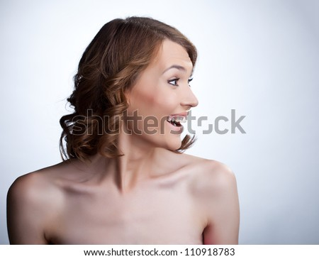 Sexy young smile woman look aside - stock photo