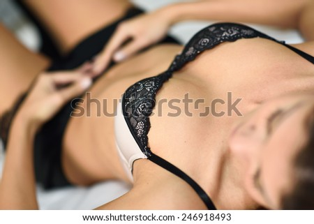 Sexy young woman dressed in lingerie - stock photo