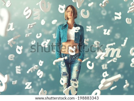 Sexy young woman in a trendy clothes with letters flying arround her - stock photo