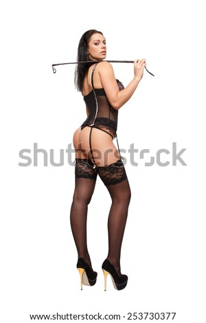 Sexy young woman in black underwear and whip, perspective view, isolated on white - stock photo